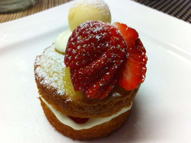 Vanilla mini cakes sandwiched with cream and strawberries