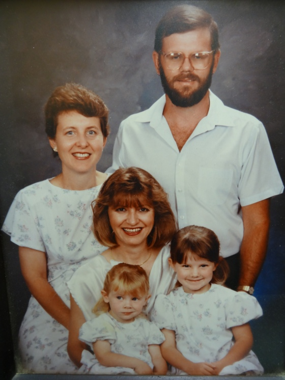 Mum, Dad, my Aunty Lone (in the middle), little me (brunette) - and little Jess - see that smirk, still has it.
